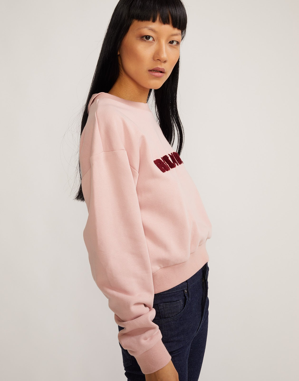Model wearing embroidered crop role model sweatshirt.