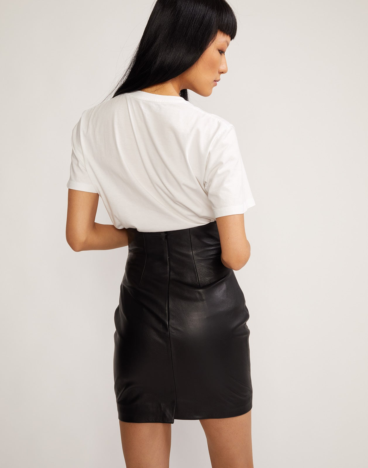 Back view of leather skirt with lace up front at waist.