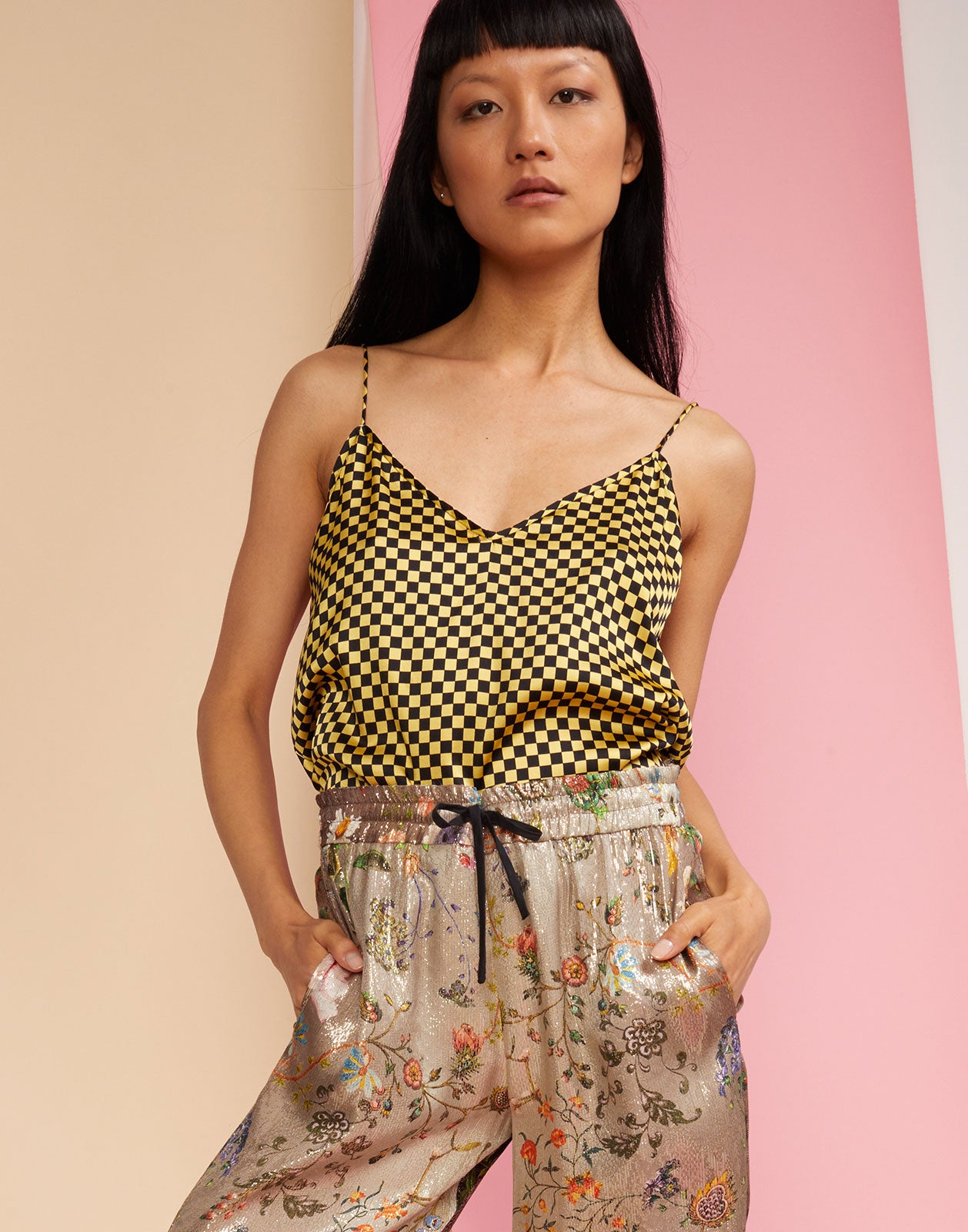 Close front view of the Checkmate spaghetti strap tank top in yellow and black check silk.