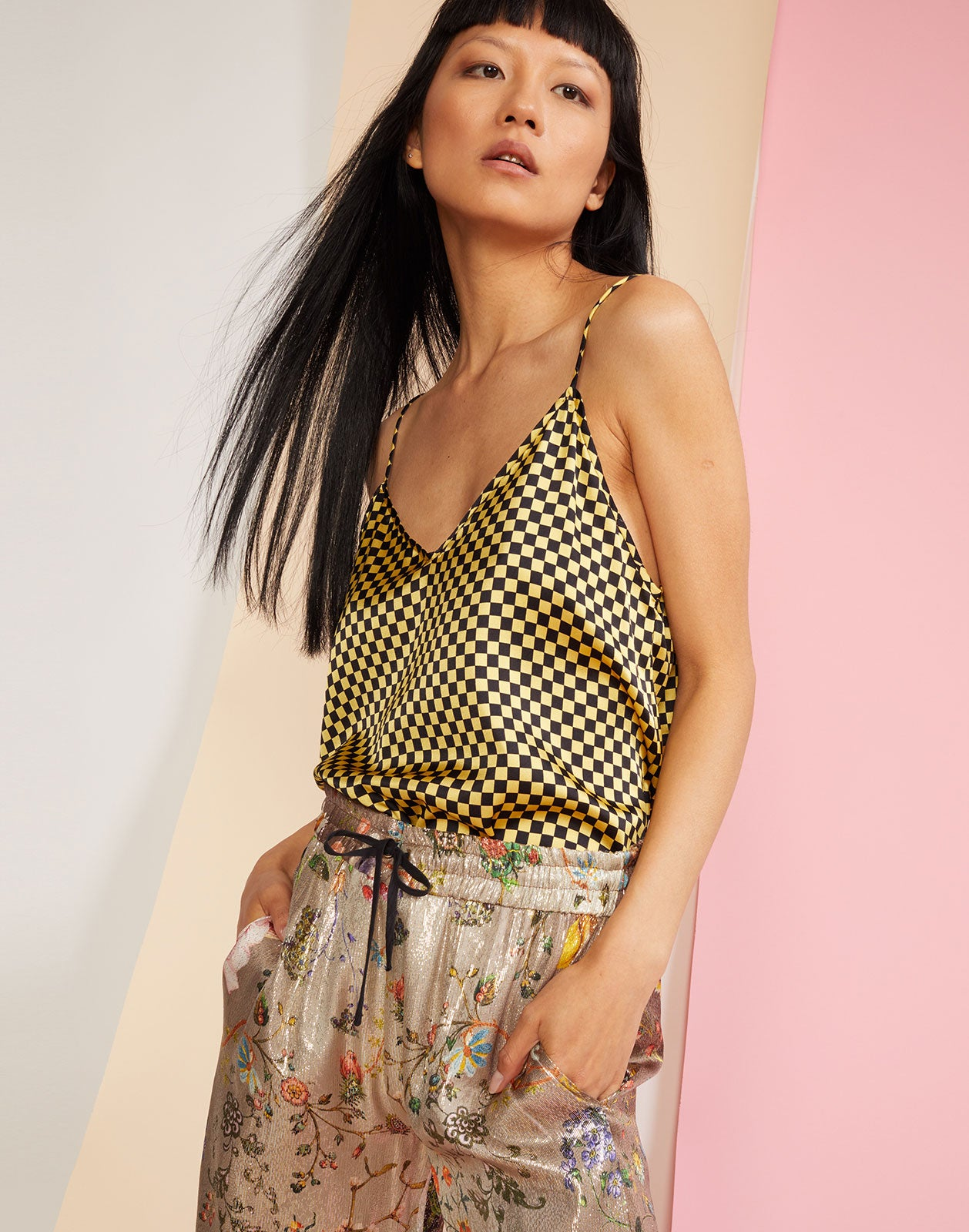 Side view of the v-neck spaghetti strap Checkmate Tank Top in yellow and black check print silk.