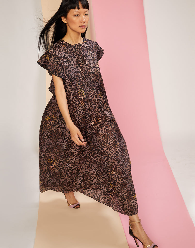 Diagonal walking shot of the lightweight cotton maxi dress in cheetah print.