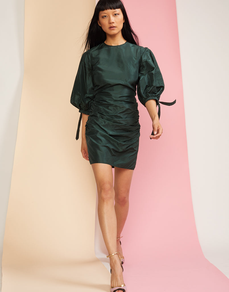 Front view of Andi rouched mini dress in emerald.