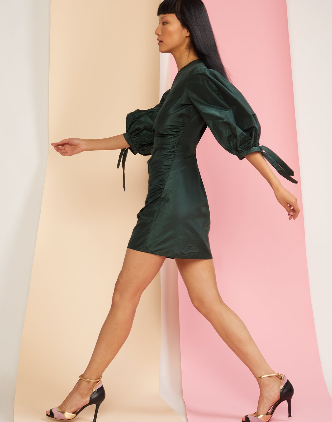 Side view of silk taffeta mini dress with oversize puff sleeves.