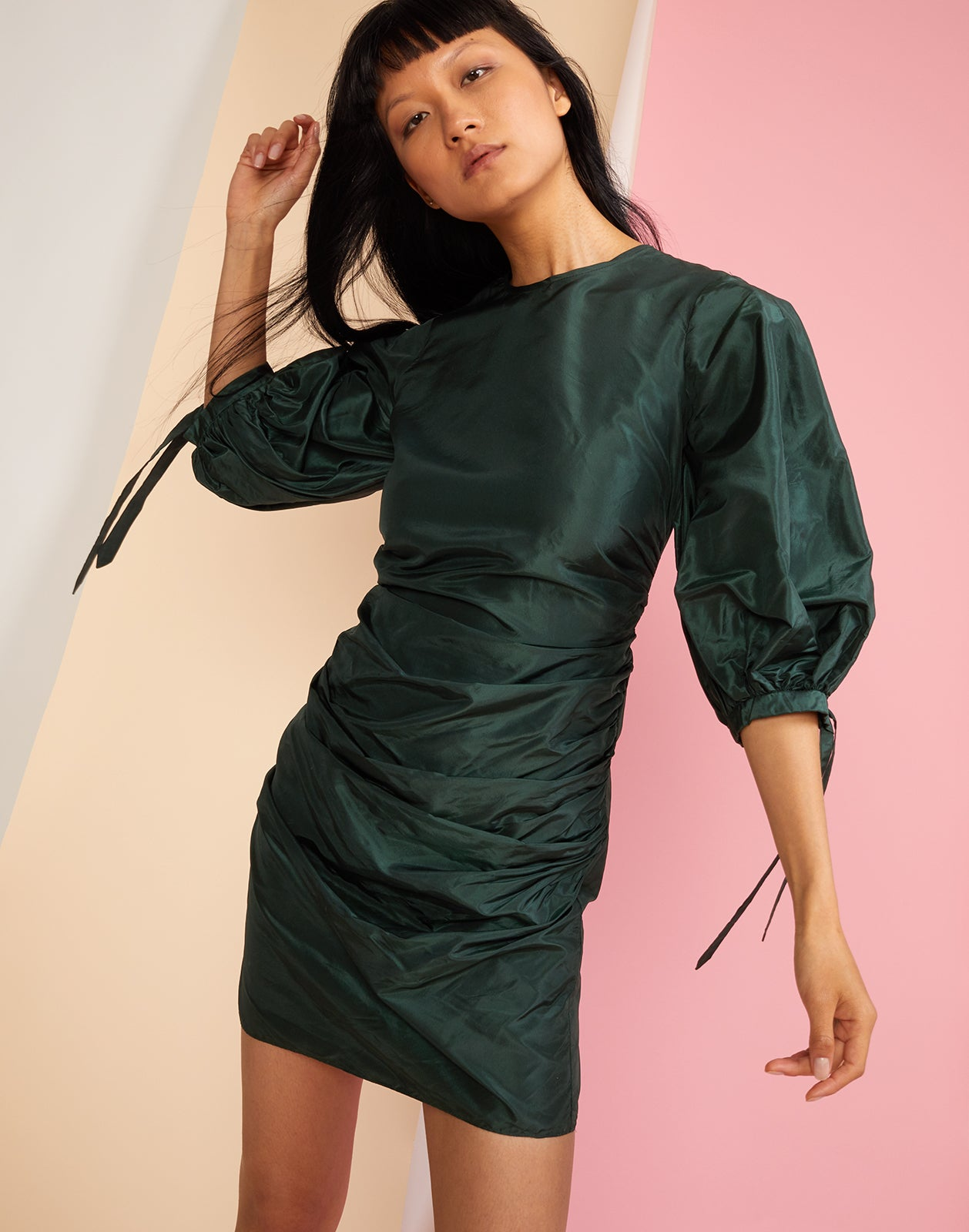 Close front view of the Andi emerald silk taffeta mini dress with oversize puff sleeves.