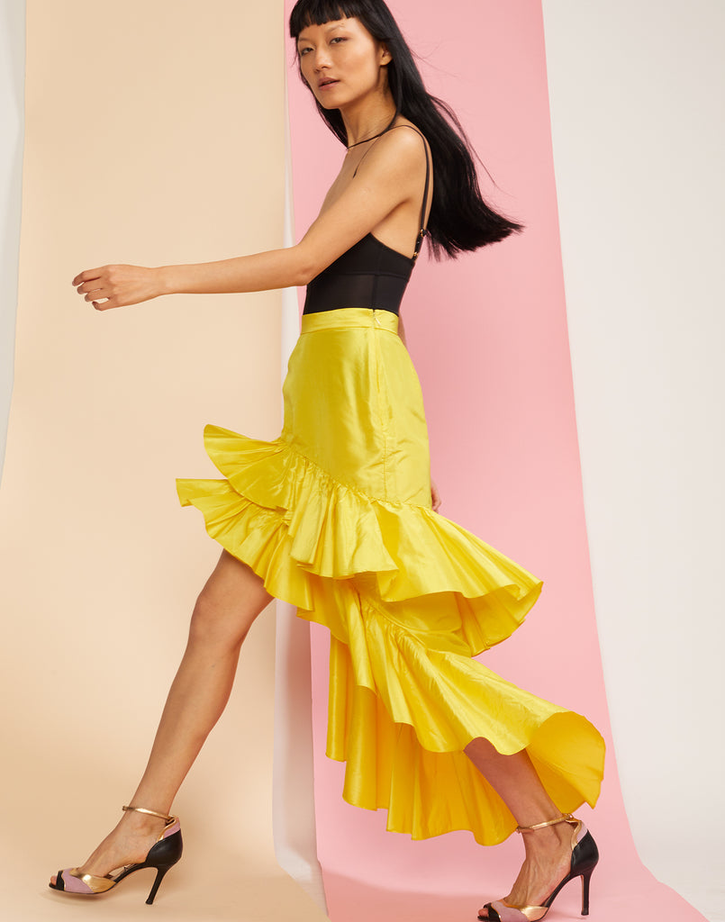 Side view of model walking in the Camila cascading ruffle silk taffeta skirt.