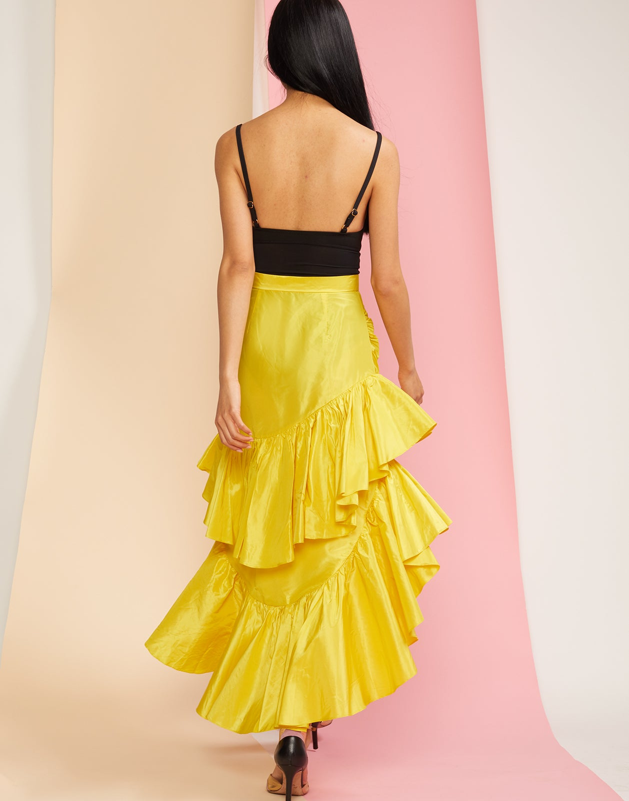 Back view of the Camila tiered ruffle skirt in yellow silk taffeta.