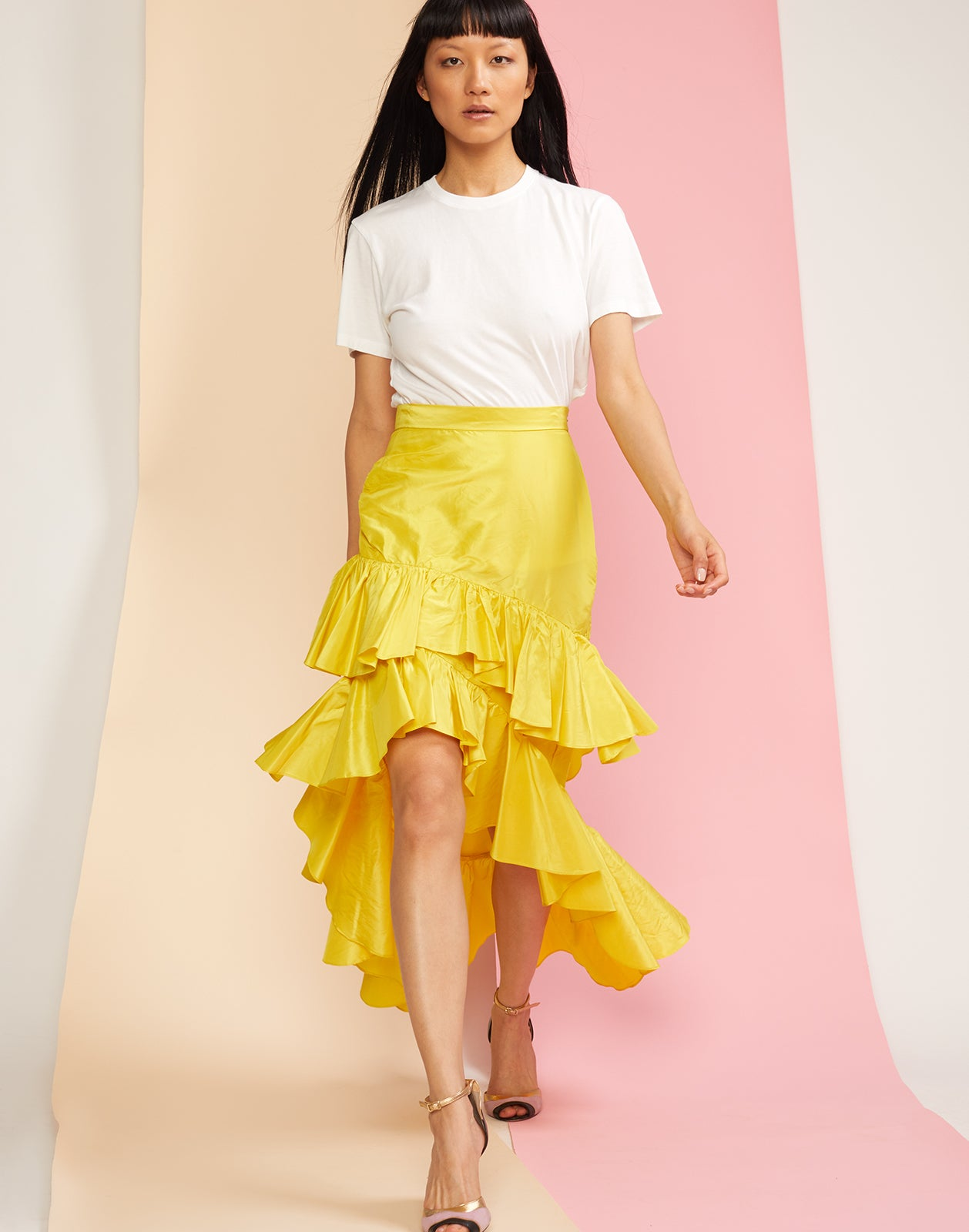 Front view of the Camila silk taffeta ruffle skirt in yellow.