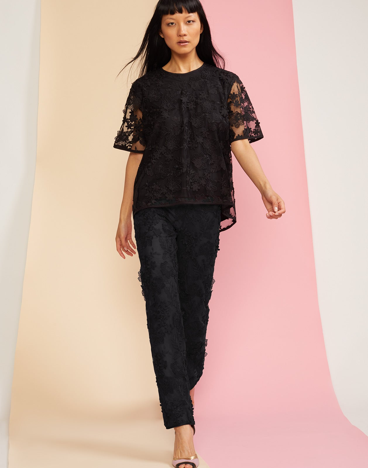 Full front view of crossfade lace tee and pants in black.