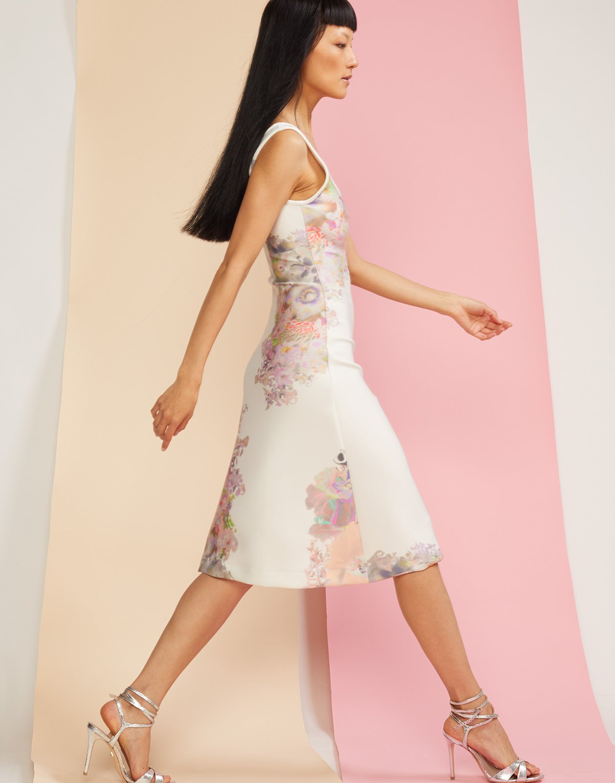 Side view of floral printed scoop neck dress in bonded nylon.