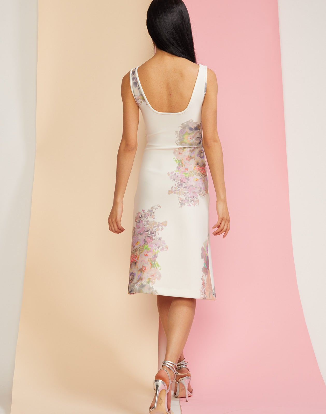 Back view of floral printed scoop neck dress in bonded nylon