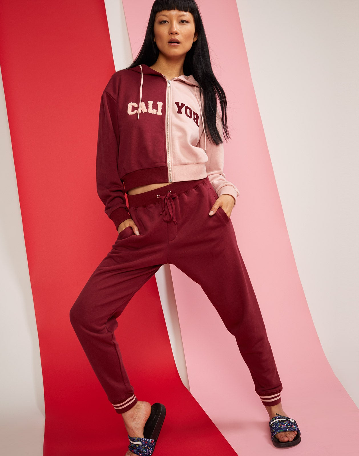 Full front view of CRxBandier sweatpant joggers in burgundy.
