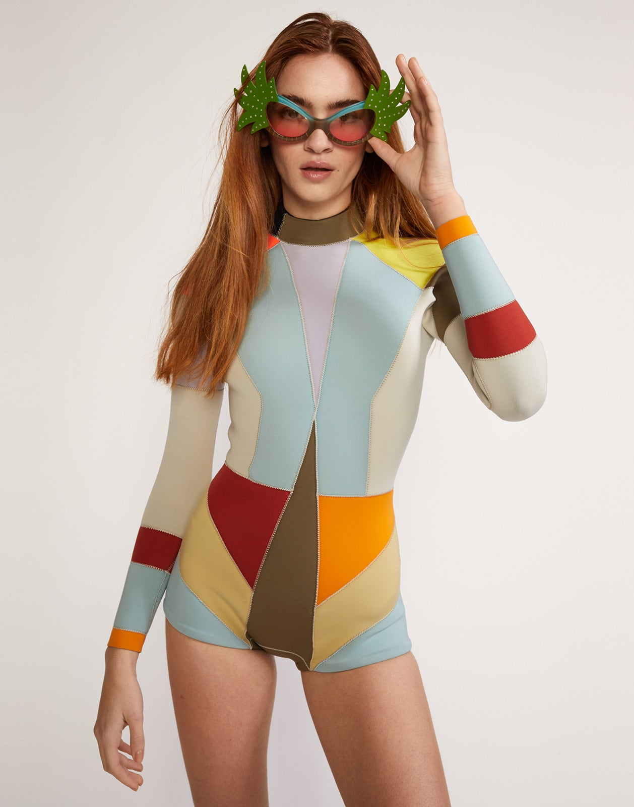 Front view of multi-color asymmetrical colorblock full performance wetsuit.