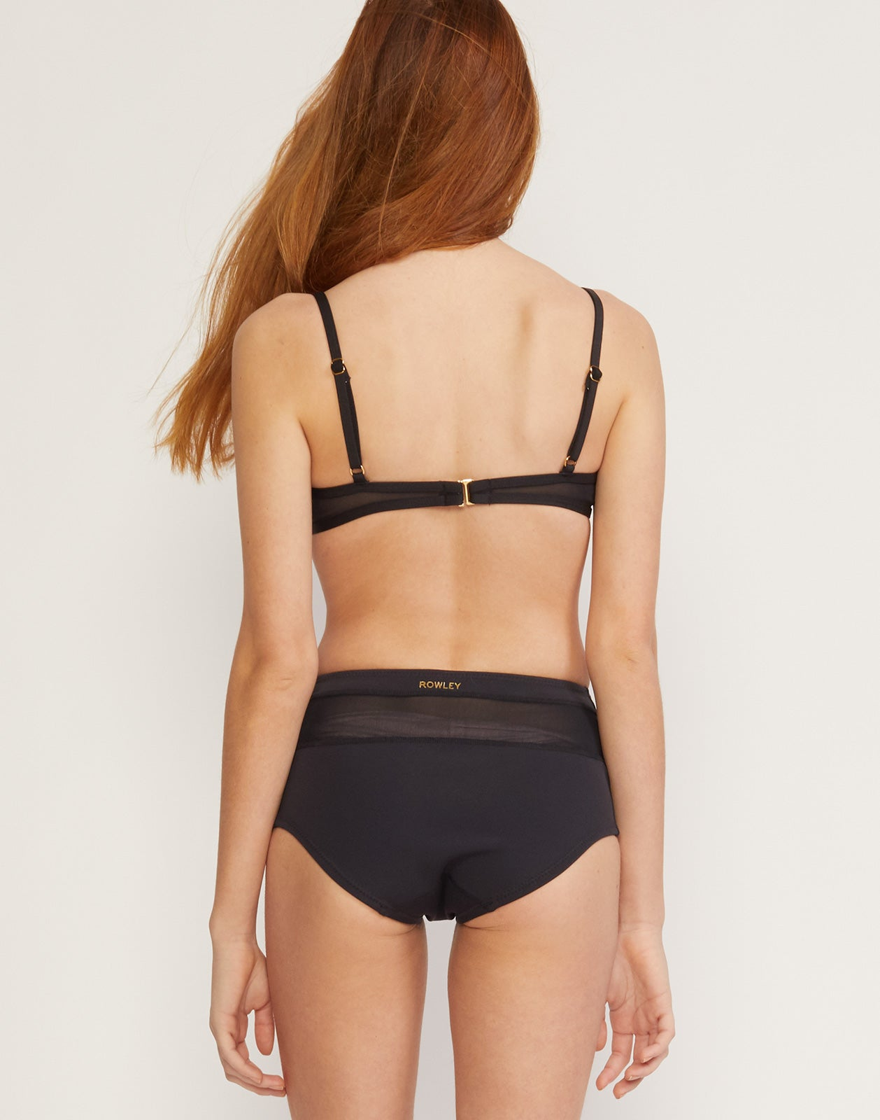 Back view of neoprene bralette bikini top with sheer mesh detail.
