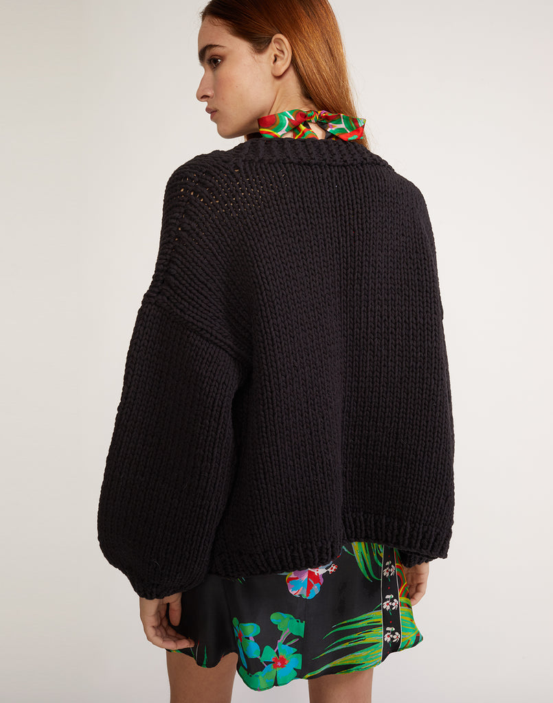 Back view of black Wallace chunky knit sweater.