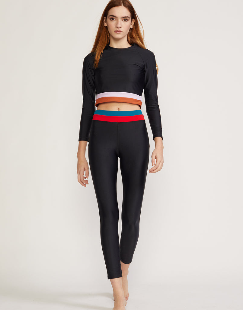 Front view of colorblock striped surf and fitness top