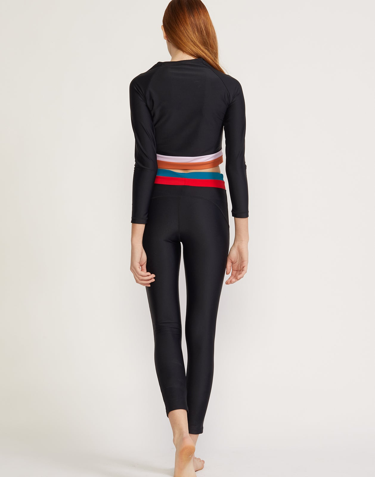 Back view of colorblock stripe surf and fitness legging.
