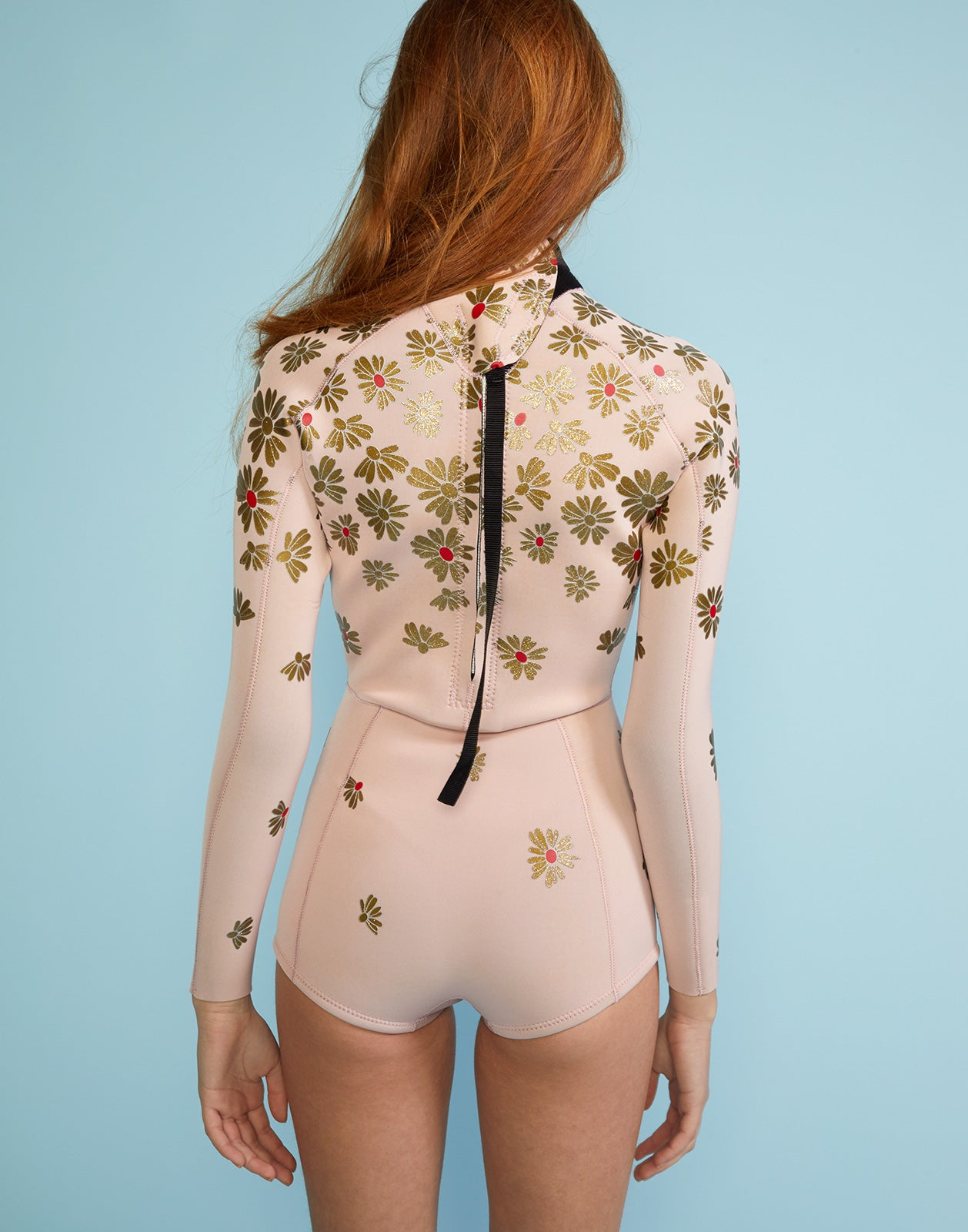 Back view of metallic floral print neoprene full performance wetsuit.
