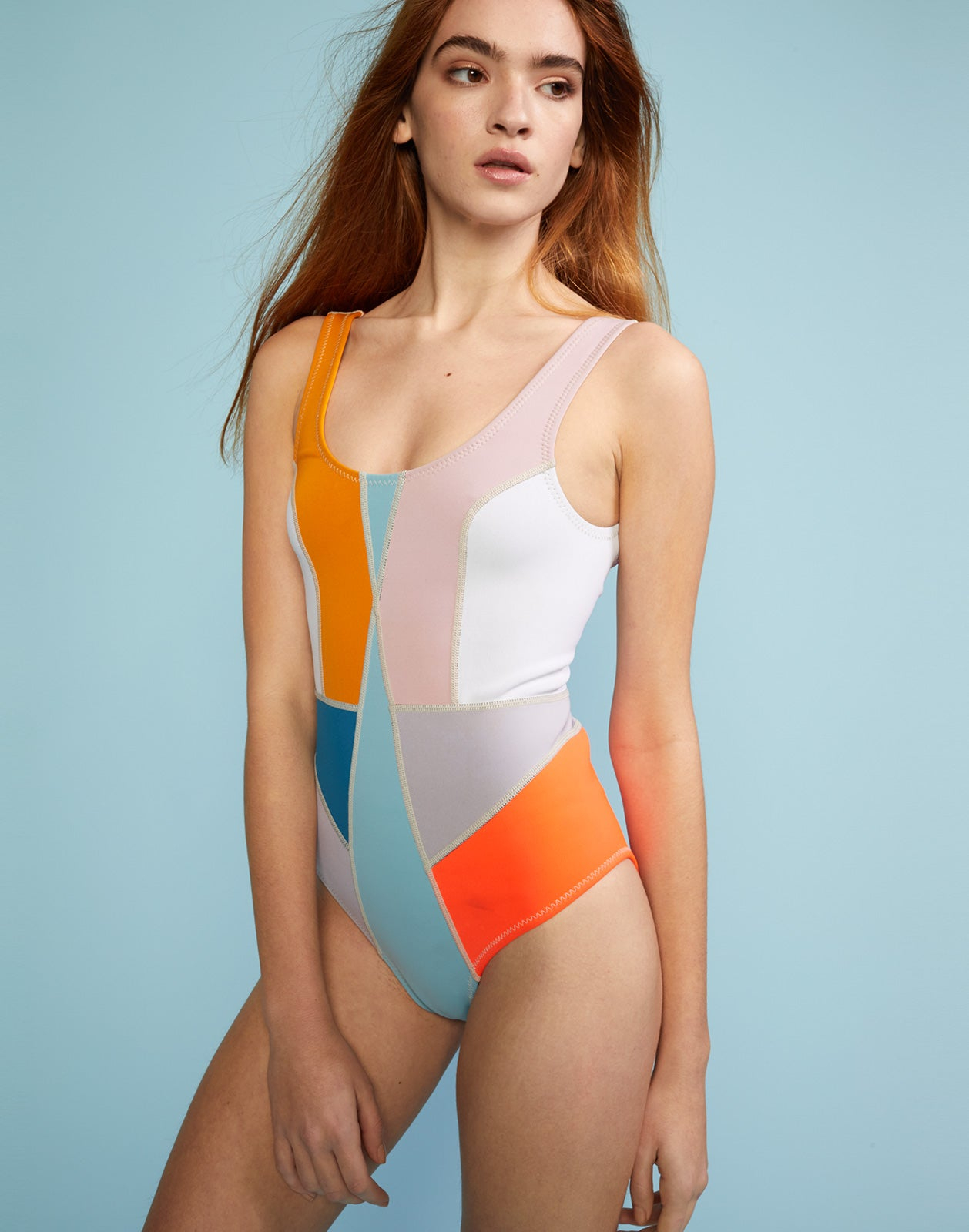 Front view of multi-color asymmetrical colorblock swimsuit.