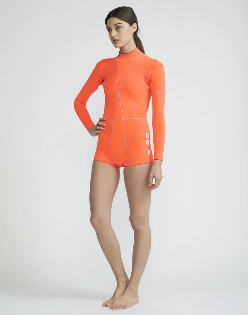Ful front view of the Faux Grommet Neon Orange Wetsuit 2MM Fiber-Lite bright orange Neoprene with faux grommets and side zips at hips