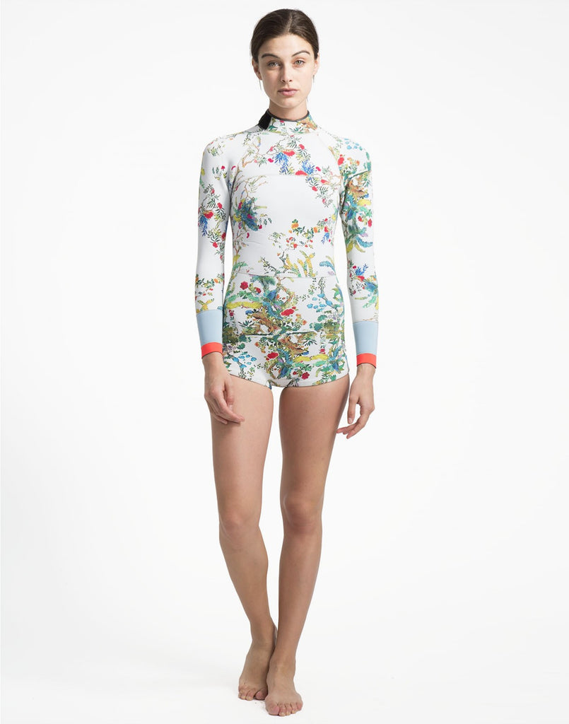 Full front view of the 2mm Neoprene wetsuit with rainbow vines print and colorblock detail at wrists