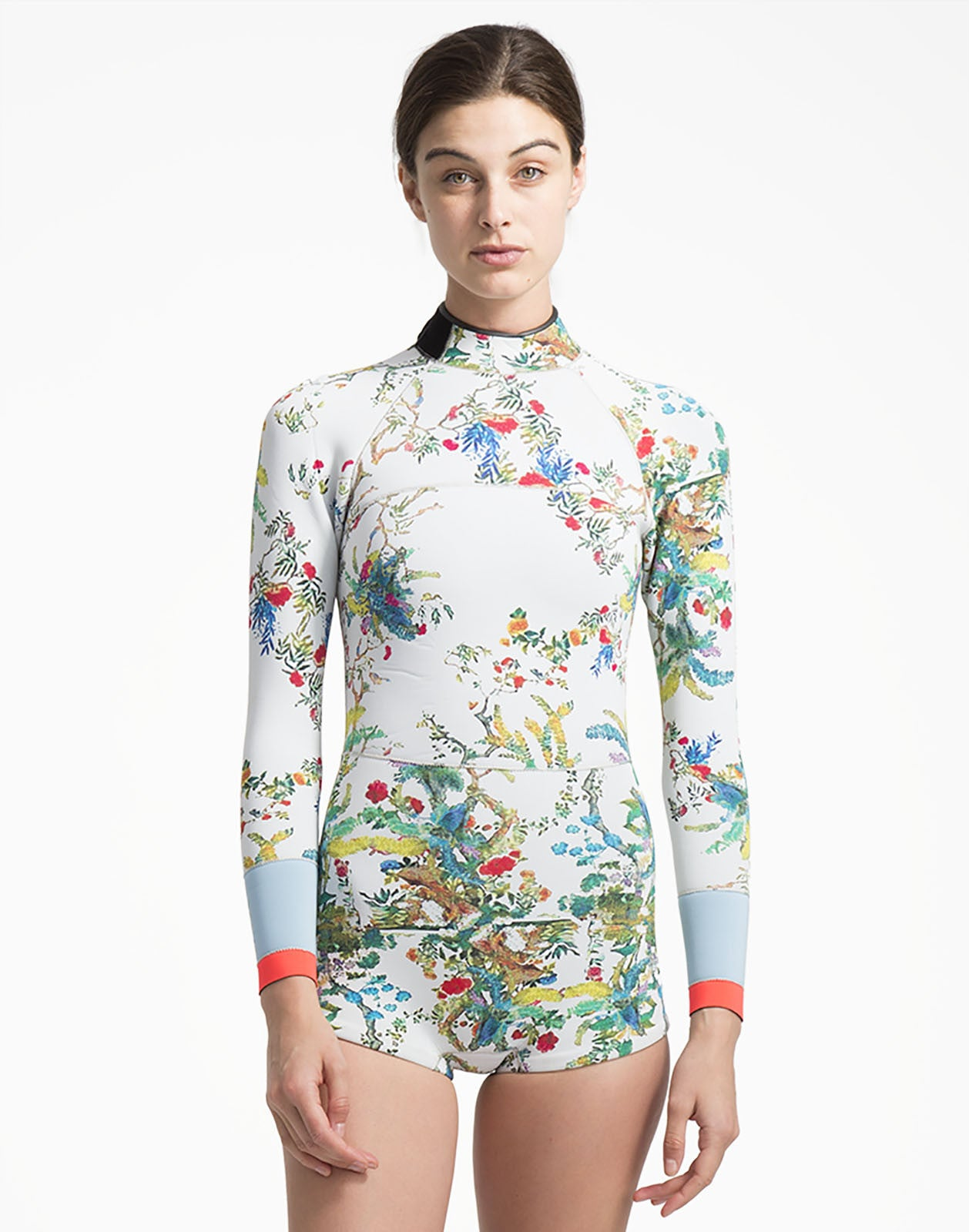 Front view of the 2mm Neoprene wetsuit with rainbow vines print and colorblock detail at wrists