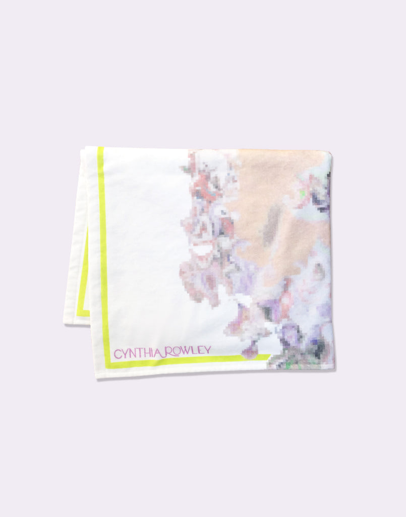 CR x Goop light floral beach towel folded.