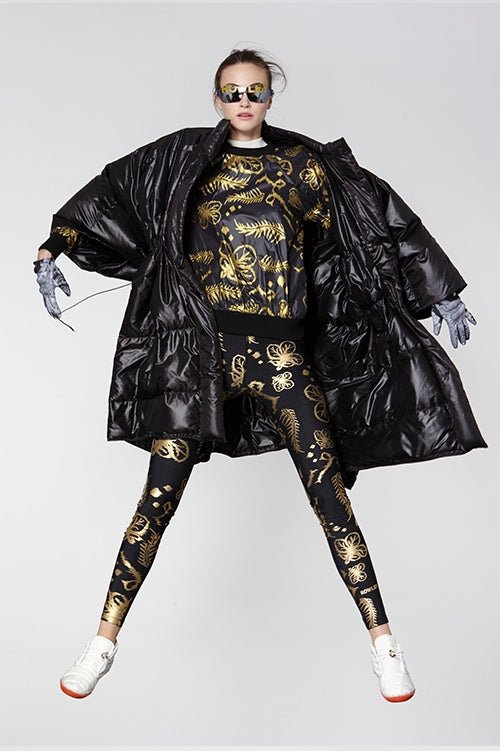 Cynthia Rowley Fall Fitness 2015 look 11 featuring gold metallic print leggings and sweatshirt and oversize black quilted coat