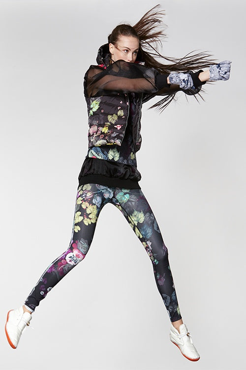 Cynthia Rowley Fall Fitness 2015 look 3 featuring dark floral print leggings and quilted down vest, and sheer black sweatshirt