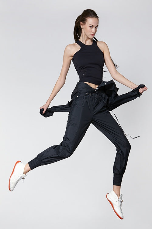 Cynthia Rowley Fall Fitness 2015 look 5 featuring a black nylon jumpsuit and black stretch tank bra top