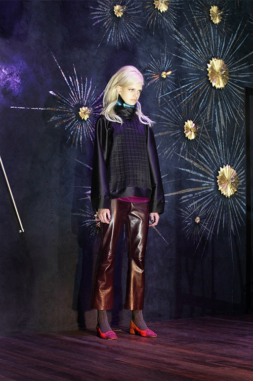 Cynthia Rowley Fall 2014 look 19 featuring a deep purple long sleeve quilted blouse with a quilted front and cooper straight leg leather pants