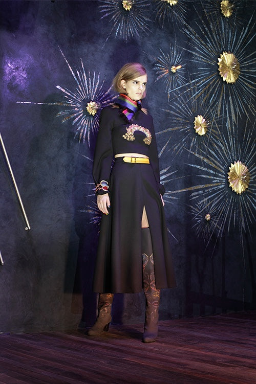 Cynthia Rowley Fall 2014 look 21 featuring a black long sleeve top with a embellished applique across the chest and a black and brown ombre calf length skirt with a slit up the side and a red green and blue silk scarf
