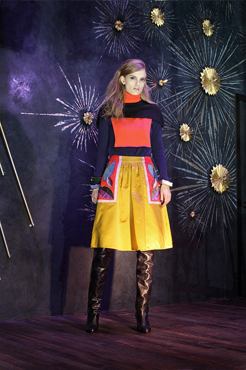 Cynthia Rowley Fall 2014 look 28 featuring a orange navy and dark blue long sleeved shirt with color blocking details on shoulders turtleneck and front with yellow knee length shorts with orange white blue and purple appliques on sides