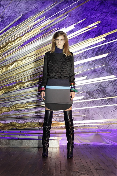 Cynthia Rowley Fall 2014 look 3 featuring a black long sleeved v neck top layered with a black and navy turtleneck top and a navy sky blue and grey striped mini skirt