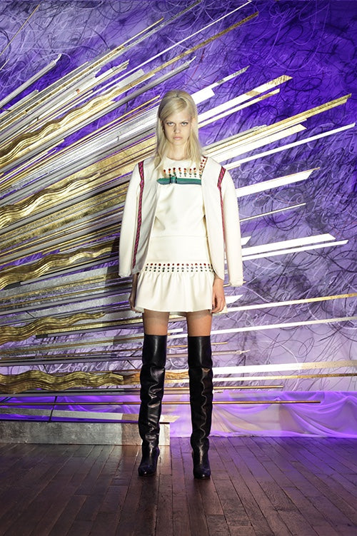 Cynthia Rowley Fall 2014 look 8 featuring a white mini dress with turquoise stripe and red turquoise and yellow polka dot details at top and bottom with white jacket with red applique stripe down the sides