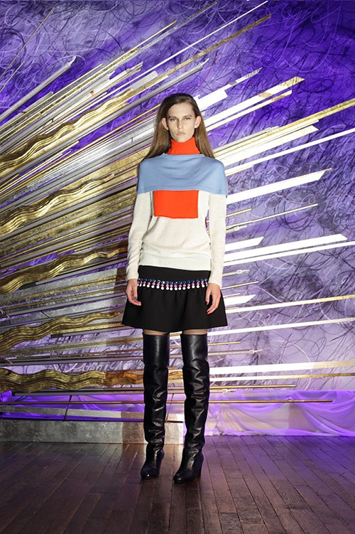 Cynthia Rowley Fall 2014 look 8 featuring a white sky blue and orange long sleeve turtle neck color-blocked sweater and a black mini skirt with navy pink and white polka dot embellishments