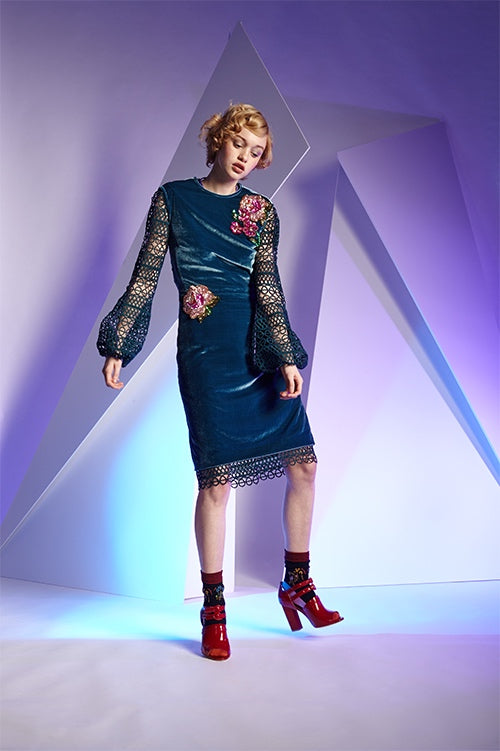 Cynthia Rowley Fall 2016 look 11 featuring a sleeveless blue knee length velvet dress with floral sequin appliqués worn over a green crochet bell sleeve dress