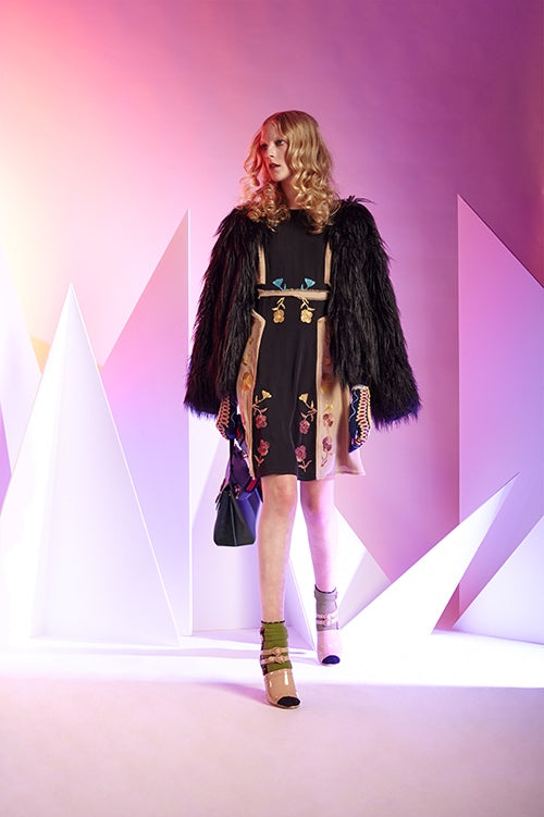 Cynthia Rowley Fall 2016 look 19 featuring a silk georgette knee length dress in black and beige with rainbow floral embroidery and hip length black fur coat