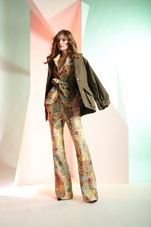 Cynthia Rowley Fall 2016 look 24 featuring chinoiserie floral jacquard cargo flare pants and blazer with waist tie, and army green cotton jacket