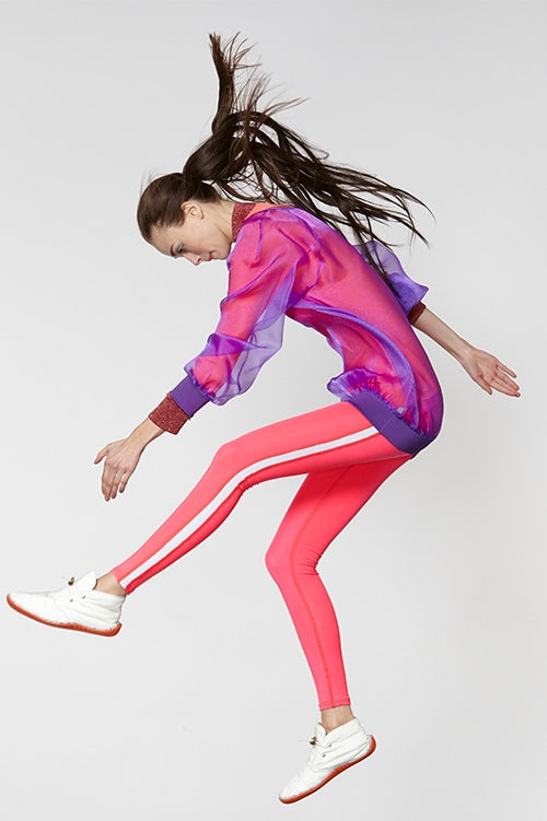 Cynthia Rowley Fall Fitness 2015 look 12 featuring pink leggings with white stripe and sheer purple sweatshirt worn over pink long sleeve shirt