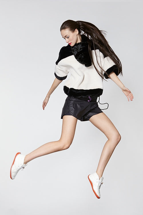 Cynthia Rowley Fall Fitness 2015 look 15 featuring black nylon shorts and black and white faux fur short sleeve shirt