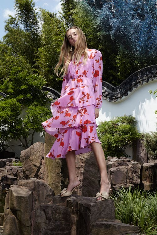 Cynthia Rowley Resort 2018 Look 17 featuring a pink poppy print asymmetrical hem long sleeve dress