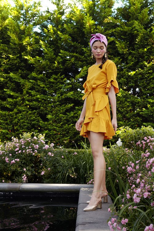 Cynthia Rowley Resort 2018 Look 30 featuring a polished cotton saffron wrap dress