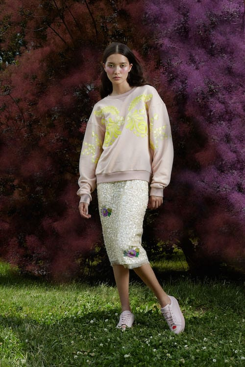 Cynthia Rowley Resort 2018 Look 6 featuring a sequin skirt and light pink sweatshirt with embroidery