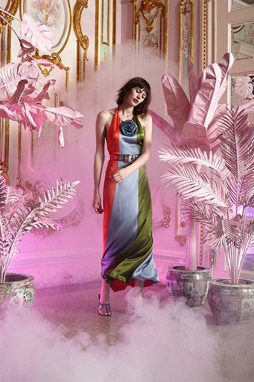 Cynthia Rowley Resort 2016 look 1 featuring a three panel silk charmeuse color block halter tie maxi dress with matching belt and silk rose pinned at neck