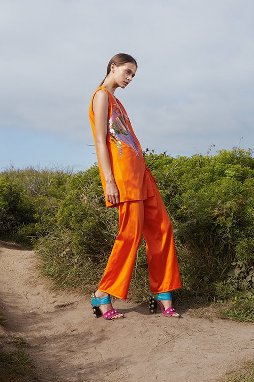 Cynthia Rowley Spring 2016 look 18 featuring orange polished cotton wide leg pants and tunic with sequin embellishments
