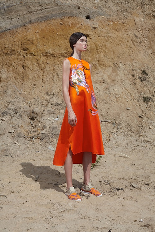 Cynthia Rowley Spring 2016 look 19 featuring an orange polished cotton sleeveless dress with front ties at chest and sequin embellishments