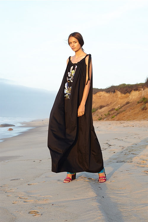 Cynthia Rowley Spring 2016 look 1 featuring a black polished cotton maxi dress with shoulder ties and sequin embellishments