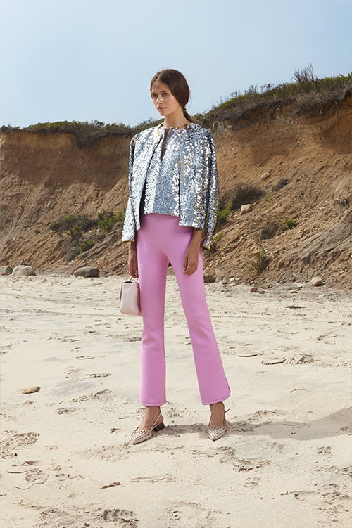 Cynthia Rowley Spring 2016 look 30 featuring pink bonded nylon cropped flare pants and silver sequin henley and cardigan