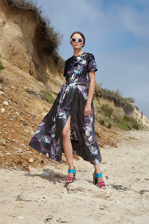 Cynthia Rowley Spring 2016 look 31 featuring a black leaf printed silk maxi skirt with front slit and waist tie and black leaf print bonded nylon t-shirt