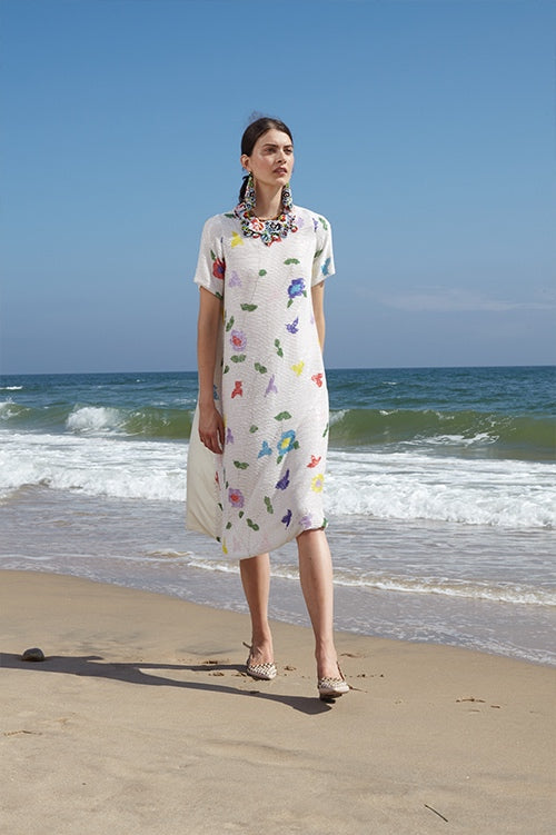 Cynthia Rowley Spring 2016 look 3 featuring a beaded floral knee length short sleeve dress